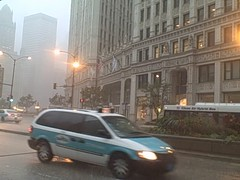 VID00002 (jdunlevy) Tags: chicago rain taxis wrigleybuilding michiganavenue cabs busses taxicabs magnificentmile