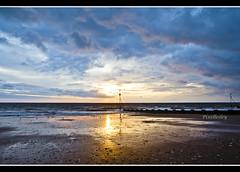 Norfolk Sunset (pixellesley) Tags: ocean sunset sea sky seagulls storm reflection beach rain birds clouds sand waves norfolk groyne