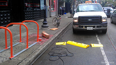 Installing the Tuff Curb (Steven Vance) Tags: road street orange wickerpark bike bicycling design wpb bicicleta transportation vlo bikerack ssa roadway dero milwaukeeavenue bikeparking bikecorral wickerparkbucktown onstreetbikeparking ssa33 bikeparkingcorral bikechi wpbrides