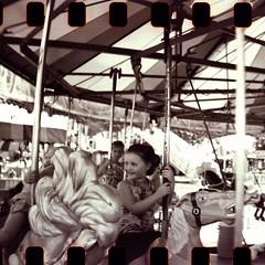 Ophelia Go Round (nbsinyk) Tags: carnival wisconsin blackwhite panoramic 35mmfilm portage sprockets columbiacountyfair lomographycamera sprocketrocket