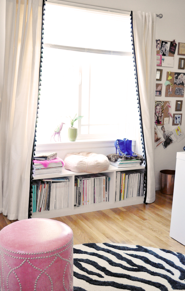 office window with storage bench  + pink studded ottoman
