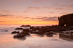 blushing (Andy Kennelly) Tags: california pink sunset beach wet clouds reflections coast la los rocks long exposure day arch angeles malibu blushing pwpartlycloudy