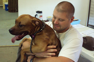 Jeff Popowich holds Scrappy, one of the shelter's favorite canine guests