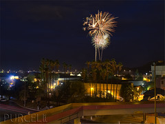Fireworks over Tucson (Jim Purcell) Tags: city longexposure summer arizona usa festival night digital photoshop mediumformat democracy downtown pentax tucson fireworks streetlights tripod citylife festivals az patriotic victory multipleexposure celebration entertainment photograph government moonlight summertime nightlife concept conceptual patriotism independenceday hdr highdynamicrange thegoodlife amountain manfrotto lightroom laplacita concepts ballhead photomatix photomechanic localgovernment tonemapping pimacounty servicetocountry tucsonphotographer tucsonconventioncenter pentax645d smcpentaxfa64580160mm45