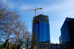 Blumau Tower, Linz (austrianpsycho) Tags: tower linz crane flags baustelle turm constructionsite kran buildingsite bauen gebude hochhaus fahnen baukran xxxlutz blumauerstrase blumautower