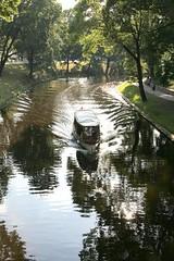 Riga: Pilstas canal (Peter Denton) Tags: city reflection green boat canal europe wake eu latvia urbannature riga waterway freshwater rivercruise pleasurecraft rga urbantrees pilstaskanls canon60d peterdenton