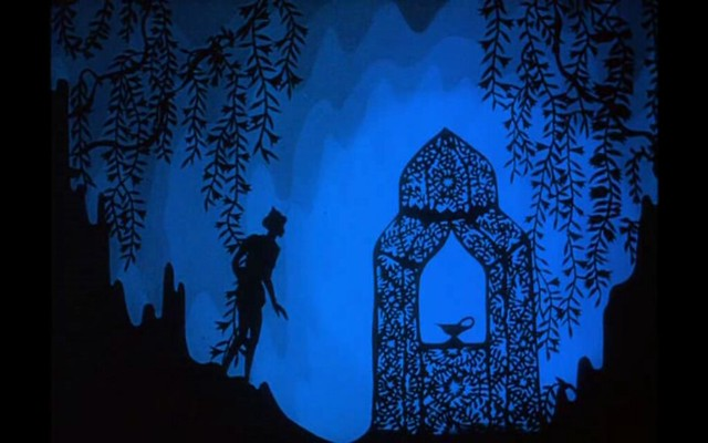An intricate black shadow design of Aladdin discovering the lamp in the cave against a blue background.