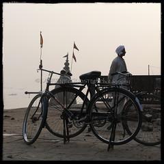 Composed of Nows (designldg) Tags: people india man heritage water bicycle mystery river square temple boat colours view flag culture atmosphere cycle soul varanasi shanti eternity dharma kashi ganga ganges benares benaras uttarpradesh  indiasong
