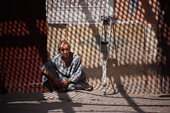 Shade (TheFella) Tags: africa light man male slr digital canon person eos photo sitting shadows mesh northafrica trellis morocco photograph figure processing marrakech maghreb 5d dslr lattice crutch moroccan crouching markii postprocessing latticework kingdomofmorocco 5dmarkii
