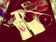 Baggage (aestheticaddiction) Tags: sunglasses pen keys coin ipod phone wallet aviation tag bad cupcake purse pens aviator contents michaels coinpurse