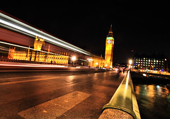 Whoosh near Big Ben (` Toshio ') Tags: road street longexposure greatbritain bridge england people motion reflection building london clock water silhouette thames architecture river gold big europe glow nightshot angle ben zoom action unitedkingdom perspective royal rail parliament bigben tilt slant royalty europeanunion thamesriver westminsterbridge toshio