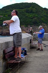 Fishing off the pier at Greve de Lecq