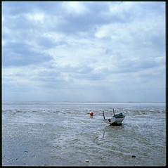 Waiting on the tide............. (david.hayes77) Tags: uk 120 6x6 film beach boat fuji norfolk estuary velvia snettisham thewash