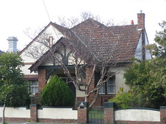 A Mock Tudor Style Villa - Ascot Vale (raaen99) Tags: door 1920s windows roof white house tree brick home window architecture facade fence garden pier gate pillar cream entrance australia melbourne victoria doorway tiles brickwall porch villa artdeco column canopy deco 20thcentury stucco 20s crepemyrtle connifer mocktudor rooftiles vestibule doubledoors ascotvale modernhome domesticarchitecture twentiethcentury sashwindows unionroad geometricpattern melbournearchitecture interwar unionrd stuccoedbrick interwararchitecture featurebricks