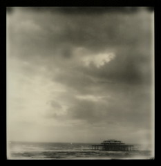 The Ruins Of West Pier 5 (tobysx70) Tags: ocean uk sea toby summer bw white black west slr english sepia clouds silver project polaroid sx70 sussex pier seaside pod ruins brighton waves hove uv poor july stormy east tip shade 600 frame week hancock channel 680 impossible roid the px choppy 2011 of roidweek therebeastormabrewin silvershade theimpossibleproject px600uv tobyhancock impossaroid