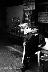 Coffee and argilla (Johanna Mifsud photography) Tags: blackandwhite lebanon coffee monochrome hat middleeast smoking beirut argilla saintrita achrafiyeh easternchristianity nikond300 johannamifsud johannamifsudphotography saintritaoftheimpossible middleeasterncultures churchesinlebanon christiandevotioninthemiddleeast christiantouristattractionsinlebanon