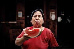 Liu Adi eating watermelon (Raphael Olivier) Tags: pictures life china street city portrait people urban woman fruit photography photo asia photographer shanghai photos eating chinese documentary lifestyle watermelon editorial reportage raphelolivier