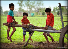 The Rural See-saw (bnilesh) Tags: portrait people india kids rural seesaw indore enviormental playnatural