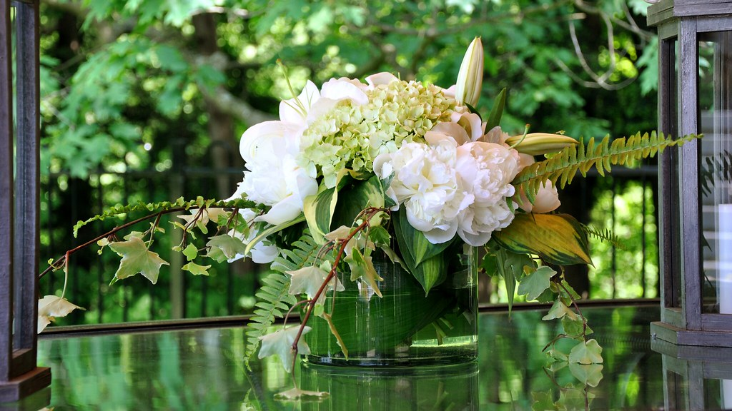 Table arrangement of lilies, hydrangeas and peonies