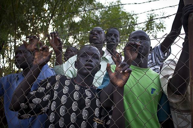 Boy watching basketball game, South Sudan. Photo copyright Conor Ashleigh