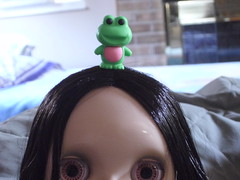 Frog on her head
