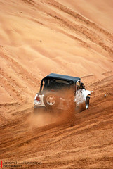 Dust Splash (Jassim H. al Langawi) Tags: orange white up sport bahrain nikon dubai desert jeep uae hobby tires arab effort splash dust sharjah  bedayer abudabi d60 wangler   uaedesert     nikond60   hoppies  jeepwangler    desertsport dustsplash  arabhobby uaehobby uaeactivity