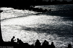 Surfing Spectators (Meremail) Tags: people bw sun beach sunshine silhouette wow surf glare surfers goldcoast shootanythingsaturday 7daysofshooting flickergolfclub ~~~api~~~ standoutimages week2waterworld