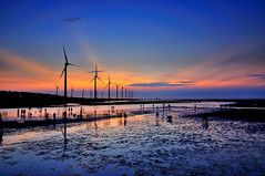 Sunset in Kaomei wetland (Vincent_Ting) Tags: sunset sea sky reflection beach water windmill silhouette clouds seaside taiwan windmills  formosa   windturbine gettyimages crepuscularrays wetland  windturbines             formose   colorfulbeach vincentting