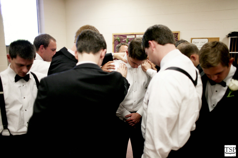 Groomsmen Praying Before Ceremony