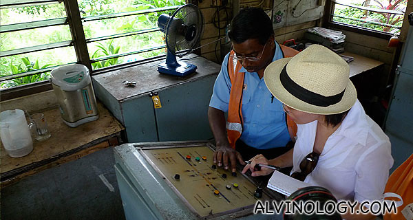 Mr Manikavasam teaching Rachel how to operate the control panel