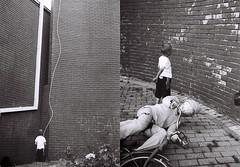 Boy vs wall (Naumoski) Tags: boy art film bike festival wall kid doll minolta gray rope ufo ohrid