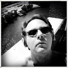 Sun Dazed and Blissful (swanksalot) Tags: blackandwhite bw selfportrait chicago headphones hooky iphone vitamind swanksalot sethanderson filmaobw