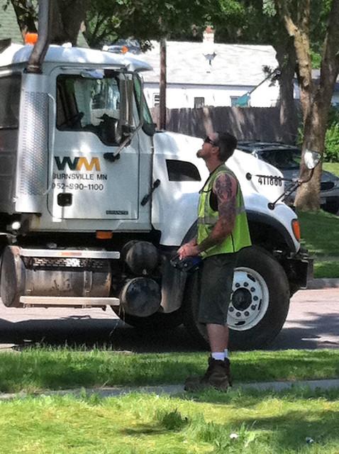 guy controlling dumpster crane