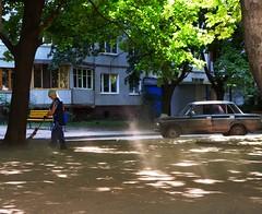 Ray of light. Cleaning up the dust. (GrusiaKot) Tags: light summer urban sun lady ray estate ukraine cleaning worker kharkov sole ukrainian luce cortile kharkiv ukraina dus raggio  ucraina  alekseevka