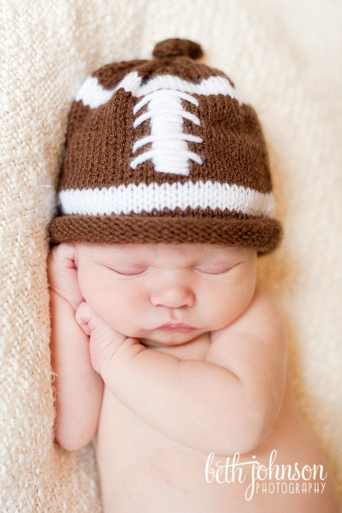 newborn baby boy in football hat