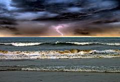 Monsoon drama (sir_watkyn) Tags: ocean india beach clouds dark waves threatening indian monsoon lightning chennai abigfave anawesomeshot impressedbeauty flickrdiamond fotocyfer sirwatkyn