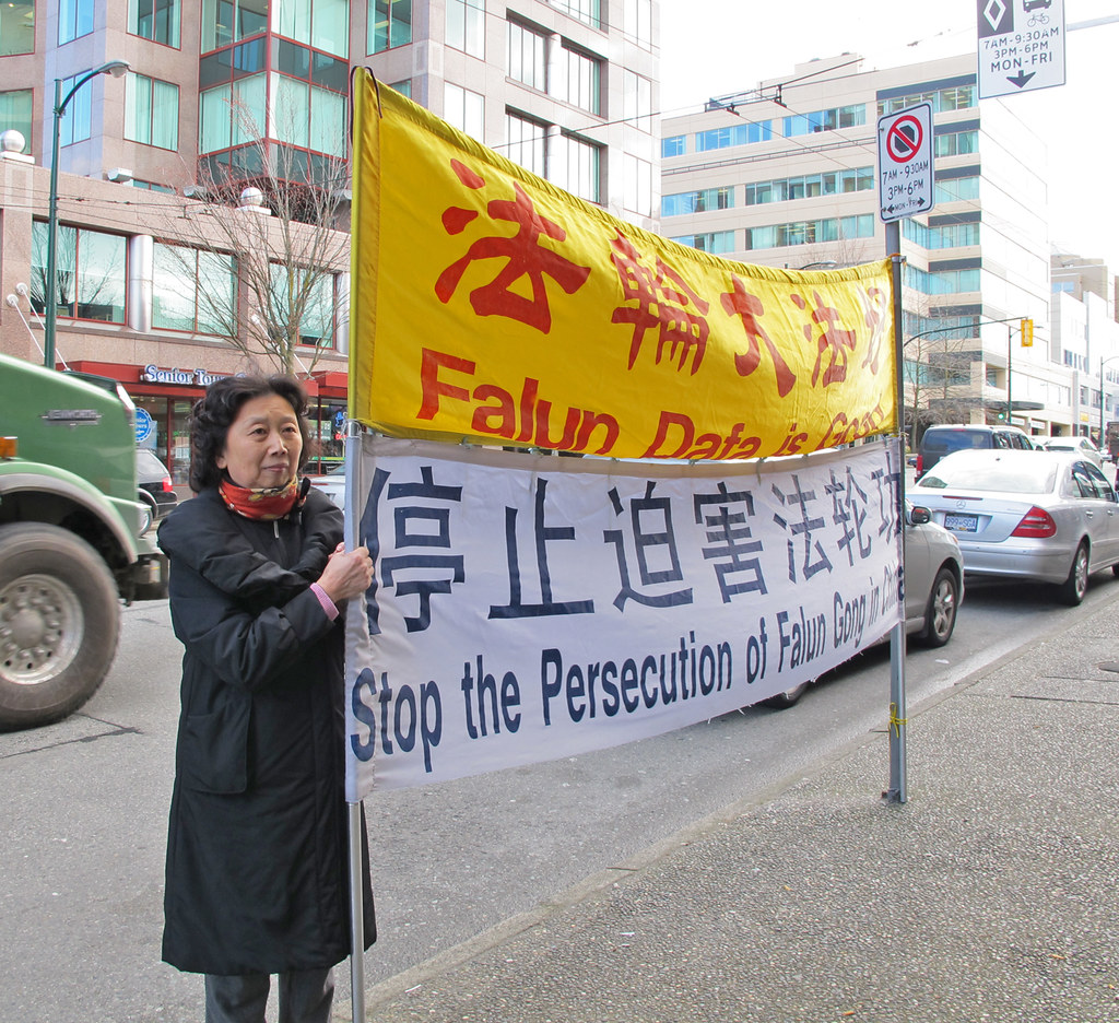 Vancouver, B.C.: CCP Exports Its Crimes Abroad ..photo of Ms. Lu Qun protests in front of Chinese Consulate