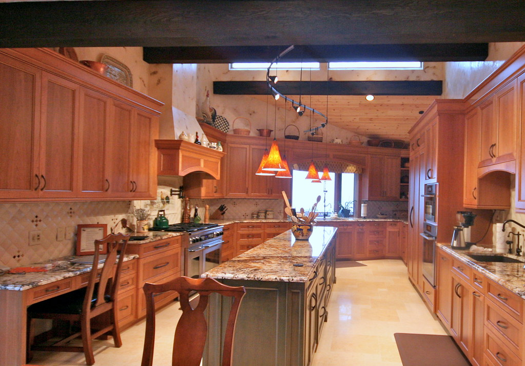 This dream home newly remodeled kitchen created by mastercraftsmen and artisans with limestone plastered walls and faux painted wooden beams. Kalama WA