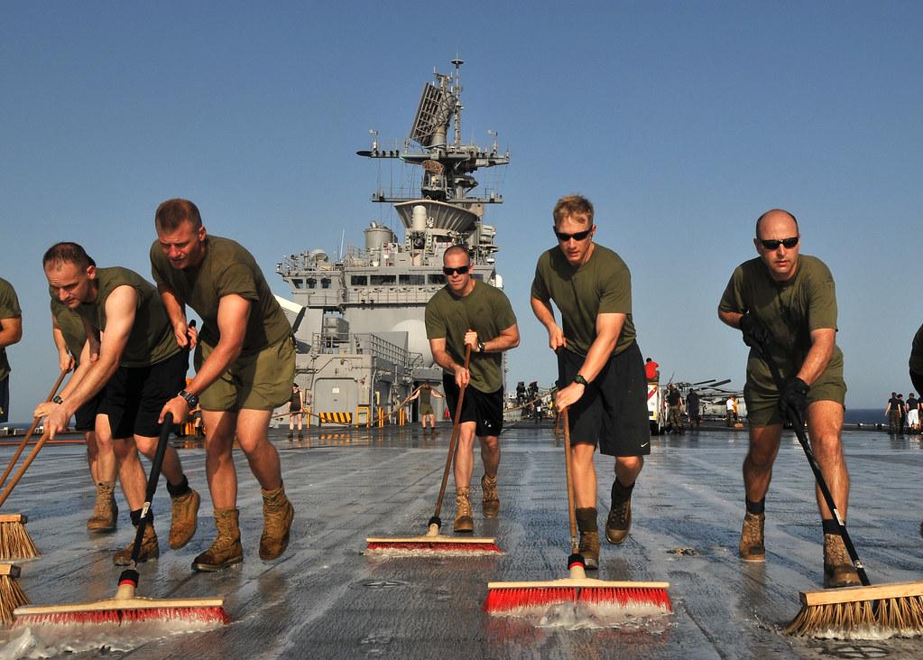 Marines wash the flight deck of USS Bataan