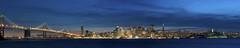 Dusk on San Francisco (Fred.Thomas) Tags: sanfrancisco california longexposure nightphotography blue sunset sea sky panorama usa cloud water night nikon cityscape treasureisland stitch outdoor dusk widescreen baybridge embarcadero bayarea northamerica nocturne magichour d300 fredthomas nightpanorama twoscreens