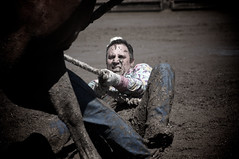 Holding On (Wake Up to a Different Point of View) Tags: wild horse canada man colour face rural work person cowboy mud boots country hard rope alberta desaturation rodeo tied vignette hold grunt roped rockyview wildhorserace