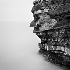 'Ying & Yang' Kilve, Somerset (Weeman76) Tags: uk longexposure sea bw seascape southwest monochrome landscape mono nikon rocks somerset minimal le limestone geology yingyang minimalist bedding d90 kilve nd110 niksoft nikkor2470mmf28gafsed silverefexpro2