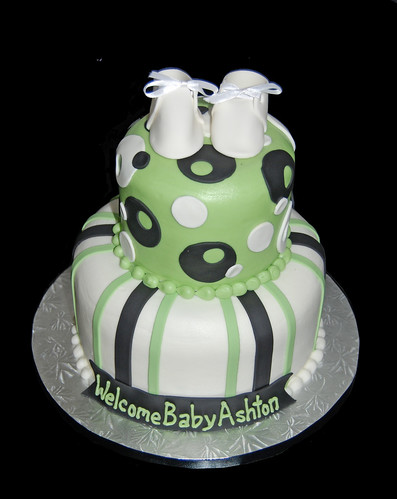 green and black 2 tier baby shower cake with booties