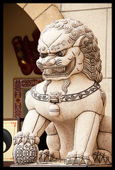 A Stone Lion Protecting the Gate (LifeisPixels - Thanks for 650,000 views!) Tags: stone museum giant lens thailand found temple is priceless sony chinese lion entrance evil objects sala off spirits historical 16 ward alpha which sian artifacts dt sien usd fee the countess believed merely chonburi a55 anek kuson viharn 18250mm lifepixels viharnra 356318250 lifeispixels sonyalphathailand lifeispixelscom