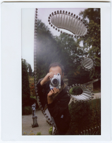 reflected self-portrait with Fuji Instax 200 camera by pho-Tony