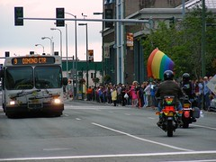 One of the buses still coming up 6th Avenue when the parade began