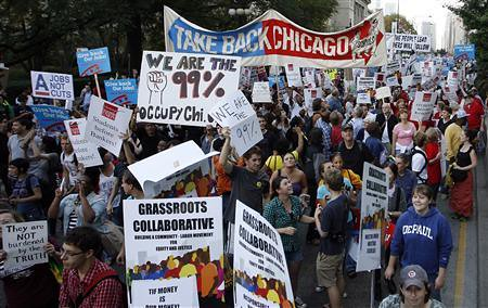 "Thousands demonstrate in Chicago on October 10 as the ""Occupy Wall Street"" movement spreads around the United States. Demonstrations have erupted that focus on the need to take control of the economic direction of the country. by Pan-African News Wire File Photos"