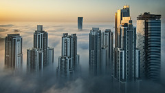 Foggy sunrise in Dubai #2 (momentaryawe.com) Tags: orange cloud sun fog clouds sunrise buildings reflections construction dubai cloudy uae foggy middleeast aerial highrise unitedarabemirates d300s catalinmarin momentaryawecom