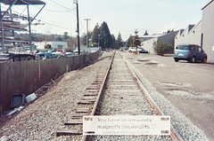 You have an unusually magnetic personality (evil robot 6) Tags: 35mm traintracks ballard disposable fortunecamera