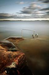 The depths II (- David Olsson -) Tags: longexposure lake water nikon sweden sigma cliffs karlstad le ladder railing 1020mm vnern vrmland lcw hss ndfilter smoothwater skutberget d5000 davidolsson nd500 lightcraftworkshop sliderssunday 2exposuremanualblend ginordicnov